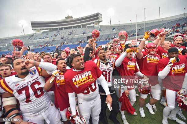 Several Iowa State Cyclones players celebrate after winning the AutoZone Liberty Bowl game between the Memphis Tigers and the Iowa State Cyclones on...