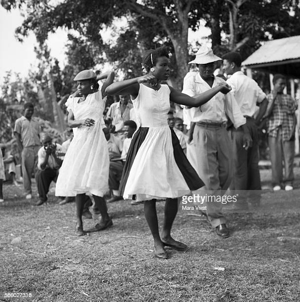 Several Jamaican couples dance together at backyard party on Jamaica