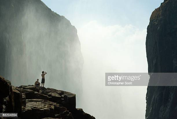 Several kayakers enjoy the view of the Victoria Falls from within the gorge, Victoria Falls, Matabeleland North, Zimbabwe