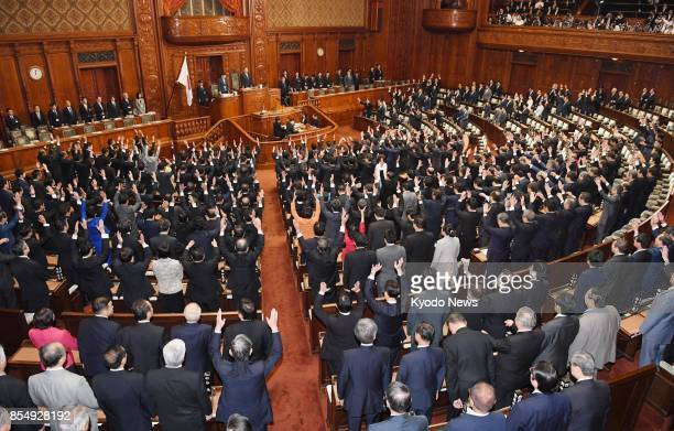 Several lawmakers throw their arms in the air in a customary banzai when the House of Representatives was dissolved on Sept 28 for a general election...