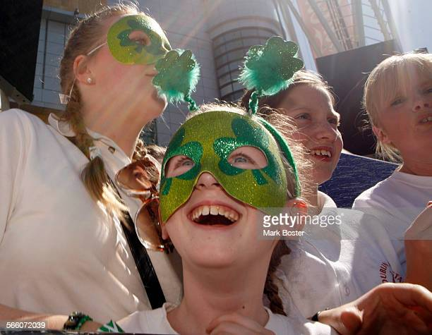 Several members of the Dublin All Stars Marching Band from Dublin Ireland get into the sprit of the Saint Patrick's Day celebration at LA LIVE in...
