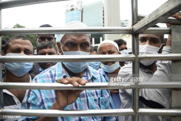 Several migrant workers are seen outside Saudi Arabia airline office waiting for their air tickets back to their workplaces in Saudi Arabia. Hundreds...