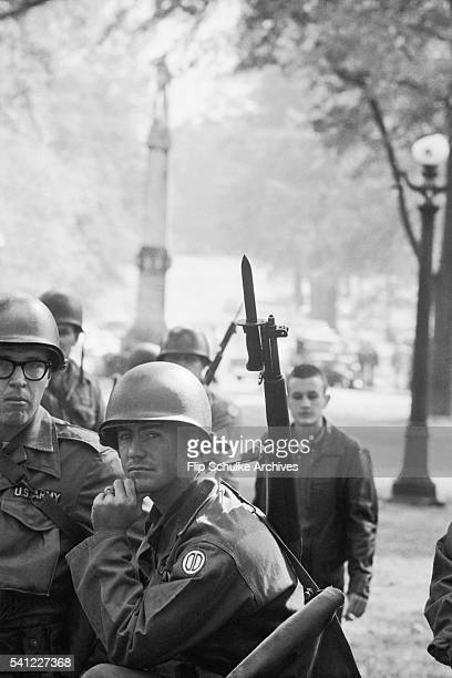 Several National Guardsmen patrol the University of Mississippi campus after riots by white students against desegregation of the campus