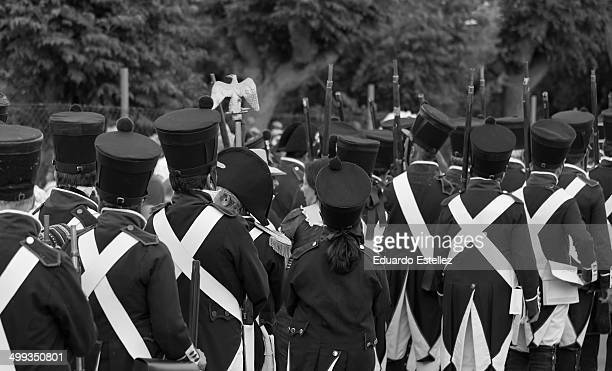 Several neighbors dressed in the costume of the nineteenth century French soldier involved in the historical reenactment of the Battle of Albuera...