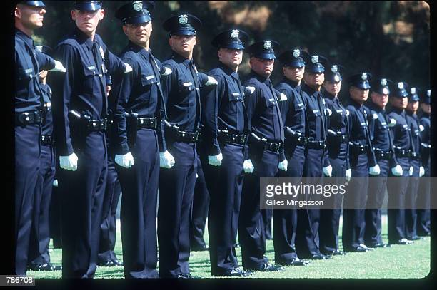 Several new LAPD officers stand in formation during their graduation ceremony May 8 1997 in Los Angeles CA Year after year the Los Angeles Police...