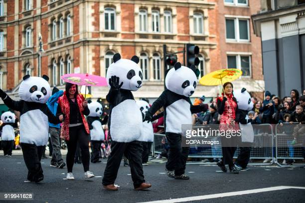 Several panda characters seen on the Chinatown streets during the Chinese New Year celebration Chinese London community celebrate the Year of the Dog...