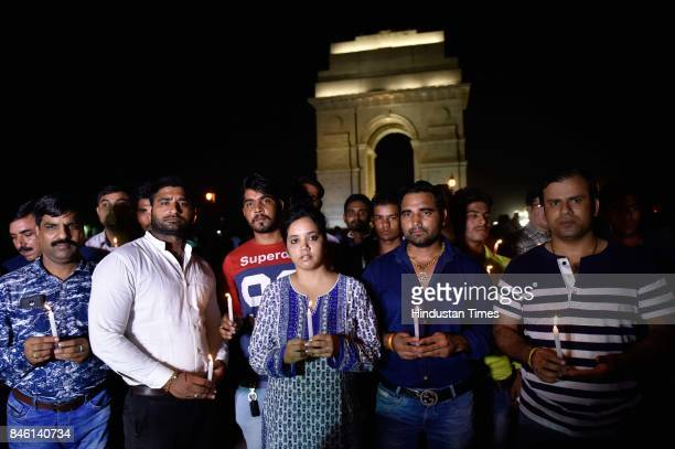 Several parents and family friends gather at India Gate to hold a candle light vigil in support of class 2 student Pradyuman Thakur who was found...