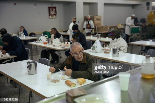 Several people eat in the soup kitchen of the parish of Carmen on Christmas Day, which can only hold 20% of its capacity due to restrictions in place...