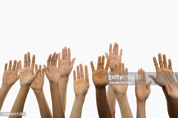 Several people holding their hands in the air