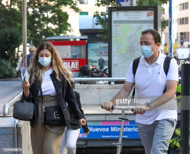 Several people leave the metro in the vicinity of Nuevos Ministerios, on June 28 in Madrid, . This is the first working day without the mandatory use...