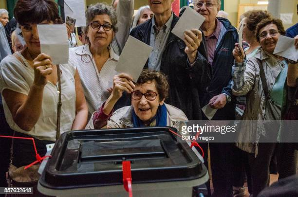 Several people seen holding up their ballot in a polling station Catalonia hosted its independence referendum on 1st October 2017 despite the Madrid...