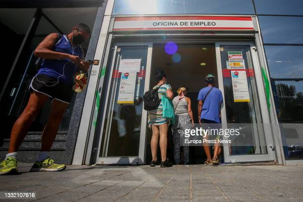 Several people wait to enter a SEPE office in Puerta del Angel, on the day the data on registered unemployment and Social Security affiliation for...