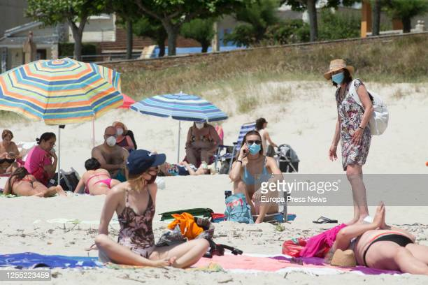 Several people with masks sunbathe on the beach of A Rapadoira in Foz in the region of A Mariña Lugo on July 09 2020 in Foz Spain On July 5 the Xunta...