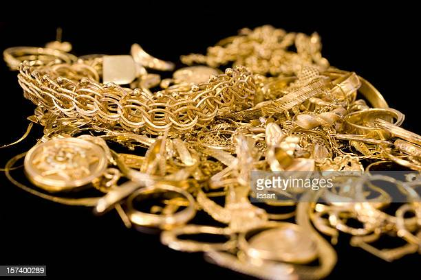 Several pieces of gold jewelry in a pile
