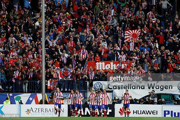 Several players of Atletico de Madrid Celebrates a goal during the Spanish League 2014/15 match between Atletico de Madrid and Valencia at Vicente...