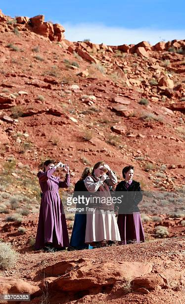Several polygamy supporters from Colorado City Arizona take pictures of a gathering at the Fourth District Courthouse November 14 2008 in St George...