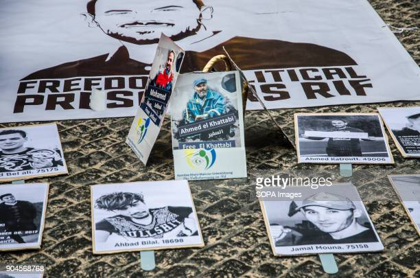 Several posters on the floor with photos of political prisoners Third March in Barcelona by the resistance freedom and justice of the people of the...