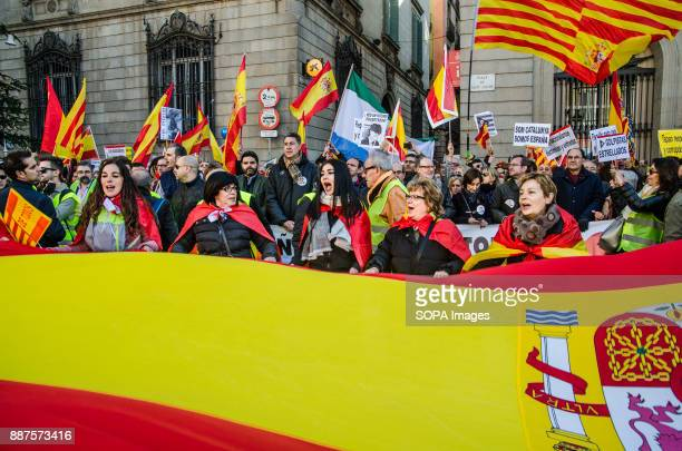Several protesters toss a large Spanish flagSpain celebrates today the 39 anniversary of its Constitution This year the celebration coincides with...