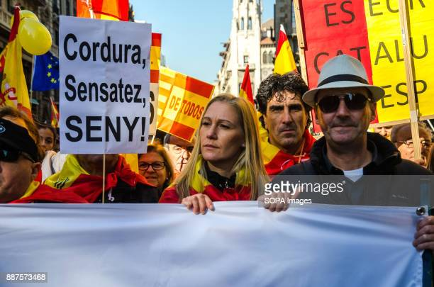 Several protesters with a sign with the text 'Sanity wisdom Seny' Spain celebrates today the 39 anniversary of its Constitution This year the...
