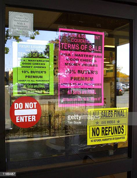 Several sale signs hang in a window of an Ames department store October 18 2001 in Chicago Ames which has declared bankruptcy protection twice in the...