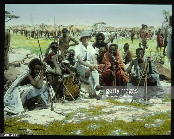 Several seminomadic Oromo camel and cattle herders pose with a Czech tourist in Benadir Somaliland 1920s | Location Benadir Italian Somaliland