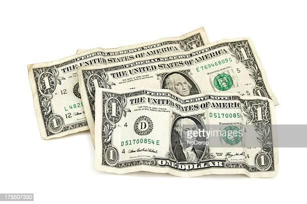 Several slightly crumpled one dollar bills