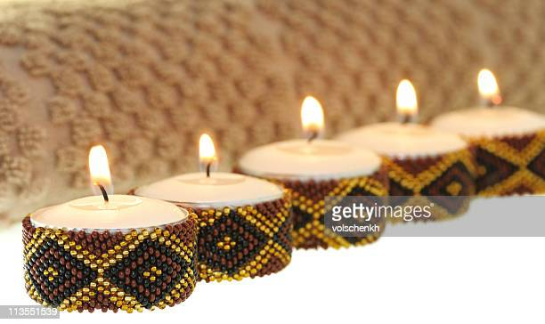 Several small spa candles with beaded diamond decoration