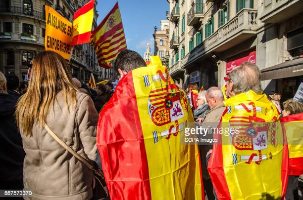 Several Spanish loyalist protesters with Spanish flags in the backSpain celebrates today the 39 anniversary of its Constitution This year the...