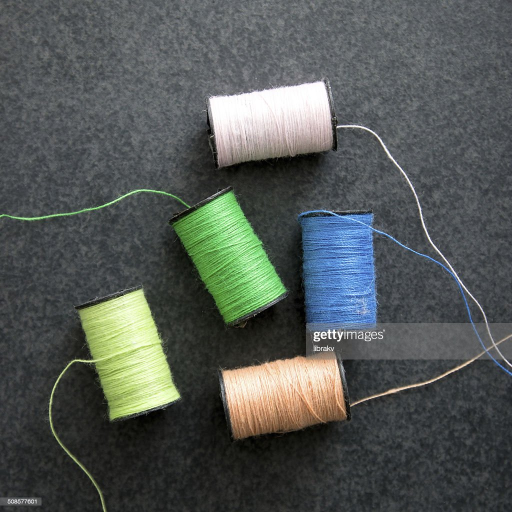 several spools of colorful thread : Stock Photo
