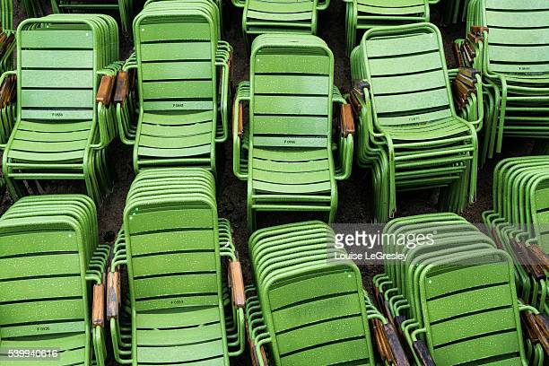 Several stacks of green chairs from the Jardin du Luxembourg in Paris, France