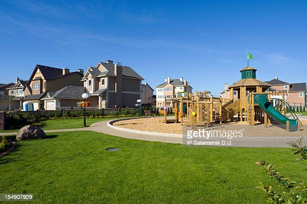 several suburban houses with wooden playground - borough district type stock pictures, royalty-free photos & images