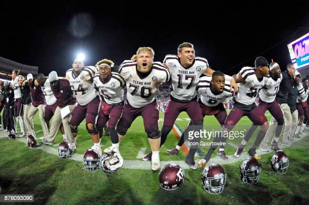 Several Texas AM Aggies players gather together to sing the Aggie War Hymn after winning a NCAA college football game against the Mississippi Rebels...