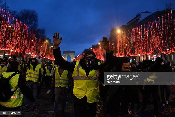 Several thousand demonstrators wearing yellow jackets gather on the Champs Elysees in Paris on December 8th 2018