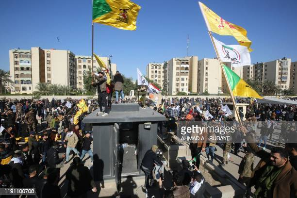 Several thousand Iraqi protesters waving flags in support of Iraq's Hezbollah movement and the Hashed alShaabi a mostly Shiite network of local armed...