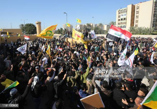 Several thousand Iraqi protesters waving national flags and banners of the Hashed alShaabi a mostly Shiite network of local armed groups trained and...