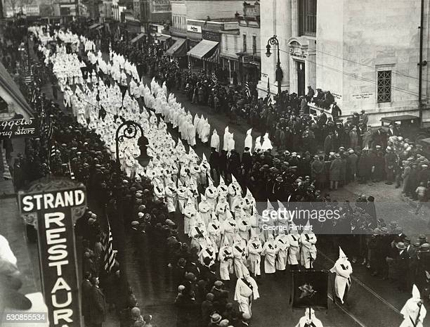 Several thousand Klansemen paraded yesterday in Red Bank New Jersey in the local Armistice Day Celebration and there were many hisses heard along the...