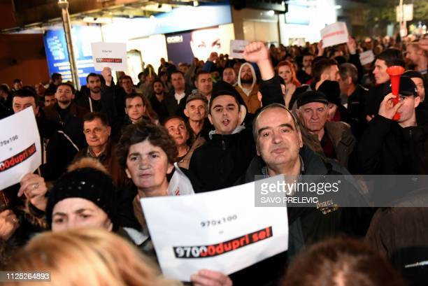Several thousand people hold posters reading 'Resist' during a protest in Podgorica demanding the resignation of Montenegro's president on February...