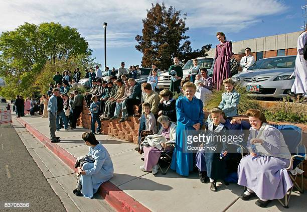 Several thousand polygamy supporters from Colorado City Arizona sit across the street from the Fourth District Courthouse November 14 2008 in St...