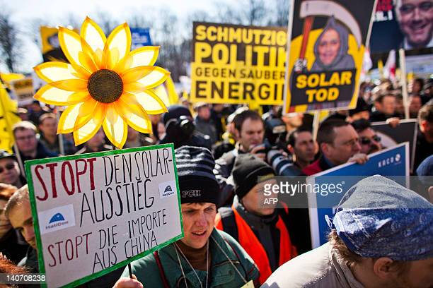 Several thousand protesters take part in a rally against government's plans to cut subsidies for the solar power sector the German government's plans...