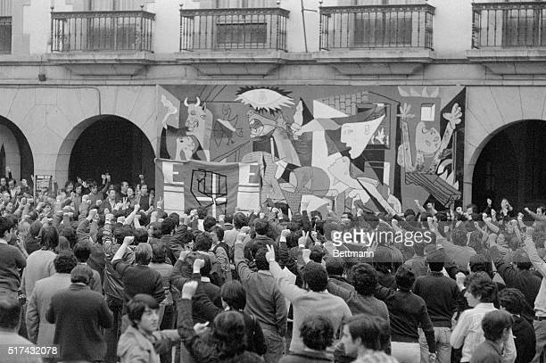 Several thousand young Basque militants raise their defiant fists to a copy of Picasso's famous Spanish painting entitled Guernica here after...