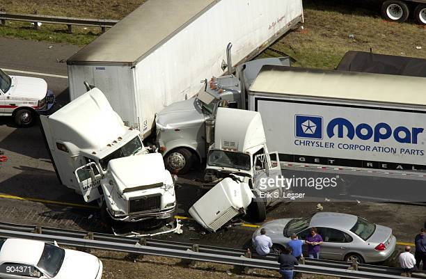 Several tractor trailers are smashed together after a multiplevehicle pile up along a foggy stretch of Interstate 75 March 14 2002 in Ringold...