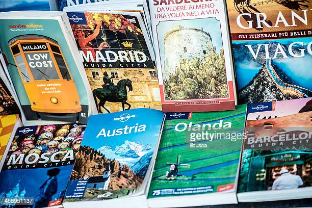 Several travel guides in italian language