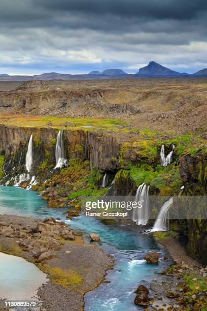 several waterfalls flowing into a river in a canyon in a remote area - rainer grosskopf imagens e fotografias de stock