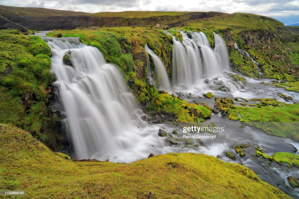 Several waterfalls in grassy land : Stock-Foto