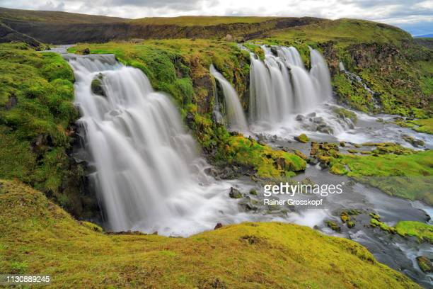Several waterfalls in grassy land