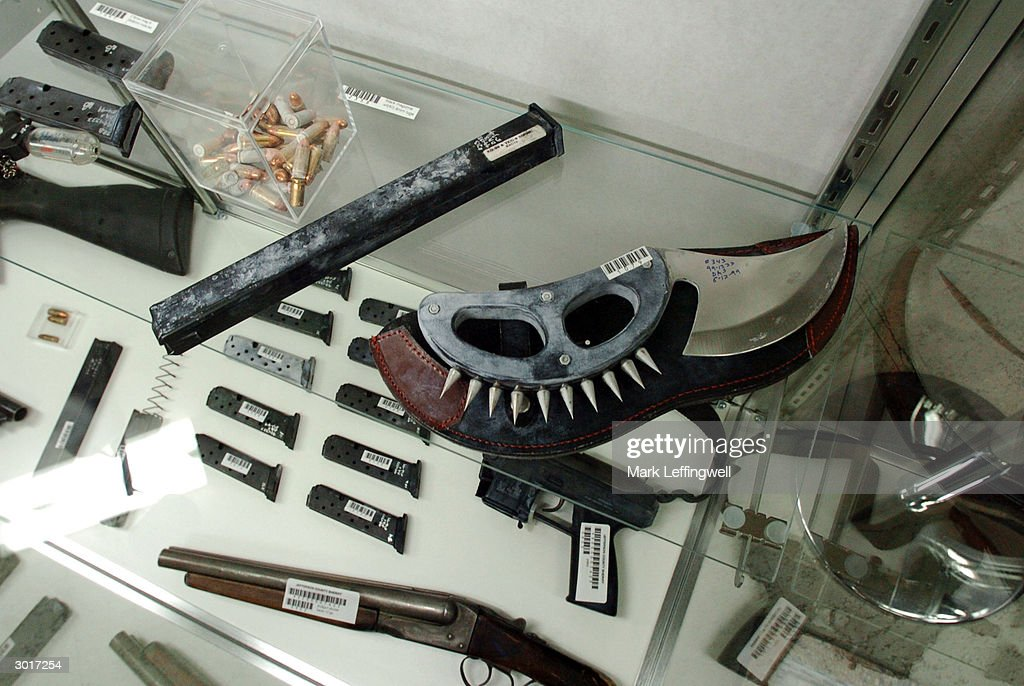 Several weapons carried by Eric Harris and Dylan Klebold, including a large knife with a spiked knuckle guard, are shown on display at the Jefferson County Fairgrounds February 26, 2004 in Golden, Colorado. Columbine students Eric Harris and Dylan Klebold killed 13 people at Columbine High School April 20, 1999 in Littleton, Colorado in the worst school shooting in U.S. history.