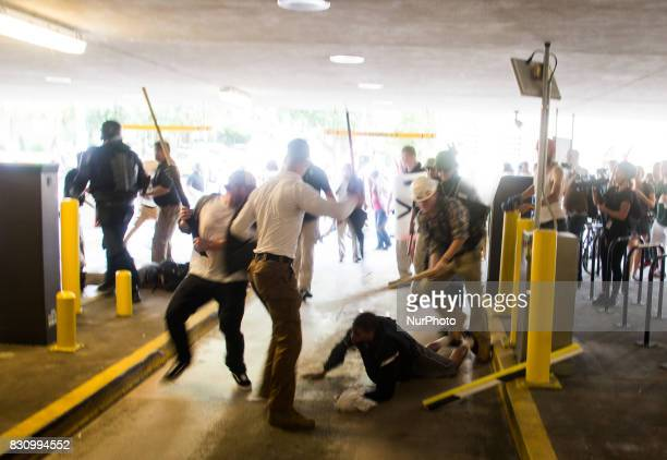 Several white supremacists attack a black man bloodying him with wooden poles and part of a broken parking arm on August 12 2017 in Charlottesville...
