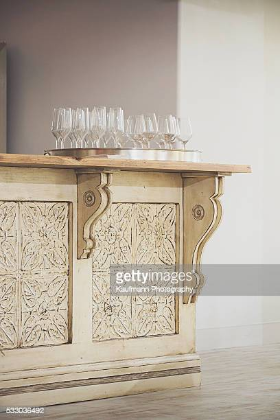 Several Wine Glasses on Decorative Countertop