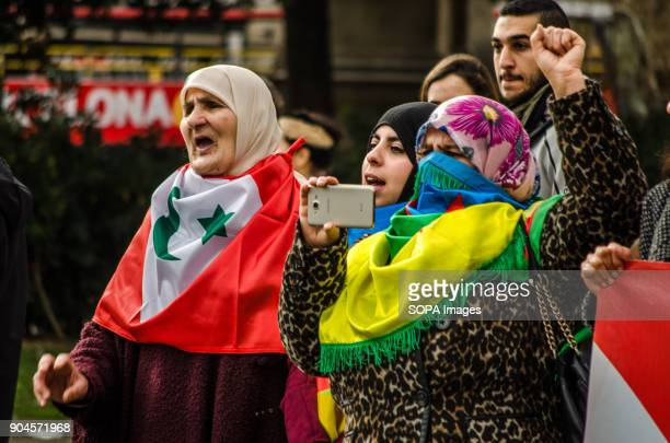 Several women protestors raised fist and seen singing political slogans Third March in Barcelona by the resistance freedom and justice of the people...