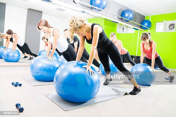 Several women taking part in a pilates class